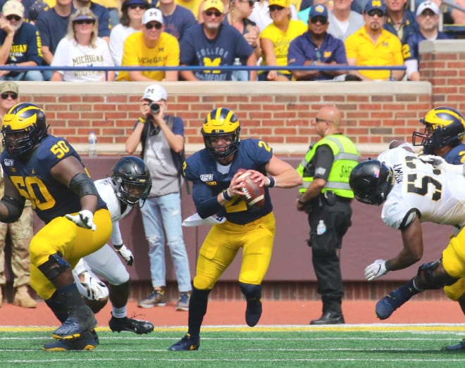 Michigan Wolverines football senior quarterback Shea Patterson completed 19 of his 29 passes for 207 yards on Saturday.