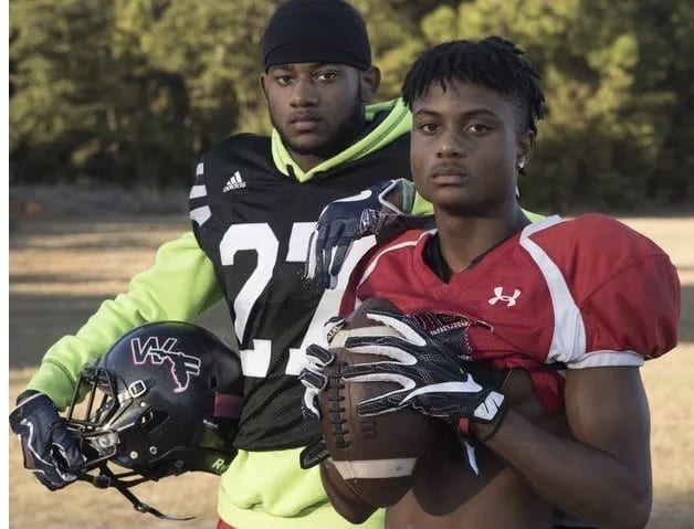 Keyshawn Helton (right) poses for a photo with fraternal twin brother Keyon during their time at West Florida High.