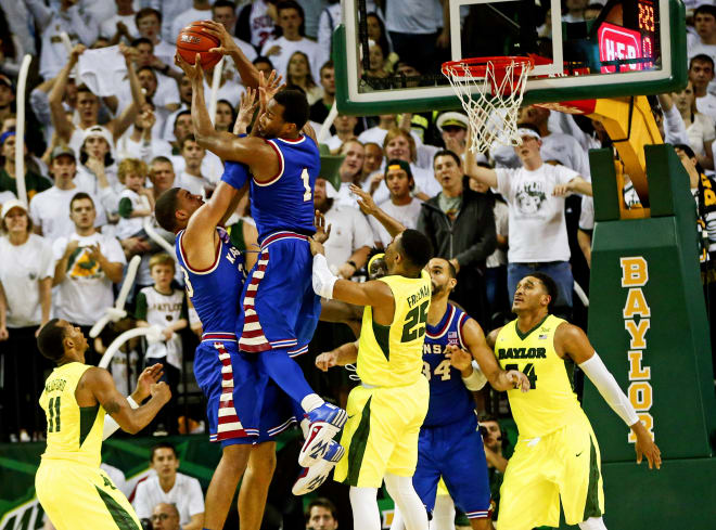 Wayne Selden, Jr., takes flight for the rebound