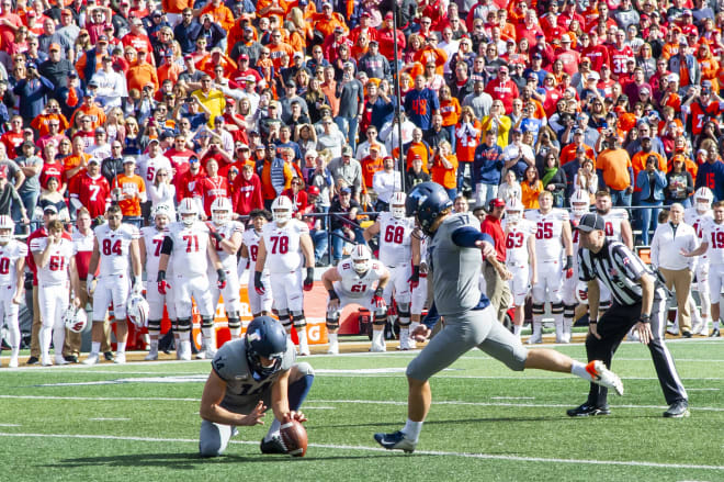 Illinois Fighting Illini place kicker James McCourt (17) kicks the game winning field goal during the second half against the Wisconsin Badgers at Memorial Stadium
