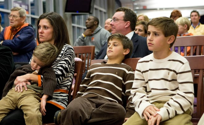 Katheen Swinney and sons look on at Dabo's news conference in 2008.  Immediately behind the family is Dabo's longtime agent, the late Mike Brown.