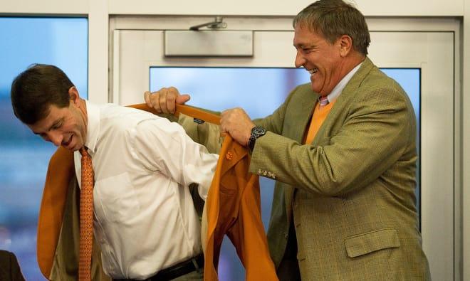 Bill D'Andrea is shown here in December of 2008 fitting Dabo Swinney with an orange jacket as Swinney is formally announced as Clemson's next head football coach.