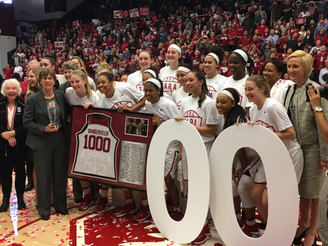 Head coach Tara VanDerveer celebrates win No. 1,000 with the team, assistant coaches and her mother, Rita, to her right.
