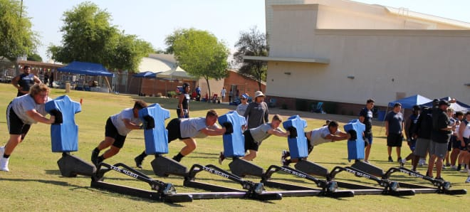 Red Mountain players take their turn pushing the five-man sled.  It was a relay with the sled having to be rotated 180 degrees at the opposite end, where another group of five would push.  The line had to run the same speed to keep it straight.