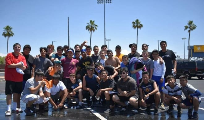 Carl Hayden players pose for a picture following their annual Car Wash Fundraiser in the parking lot of the stadium on May 11.  The Falcons will be inside that stadium on Aug. 23 for the opener against Cactus Shadows. (Photo Courtesy of Steven Arenas)