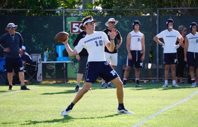 JD Johnson throws a pass during 7-on-7 competition last summer.  (Photo by Ralph Amsden)