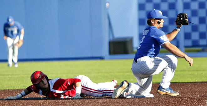 Kentucky shortstop Austin Schultz showed the ball to an umpire after tagging out a sliding Cardinal at second base.