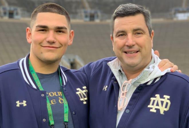 Notre Dame commit Gabriel Rubio stands next to Irish defensive line coach Mike Elston