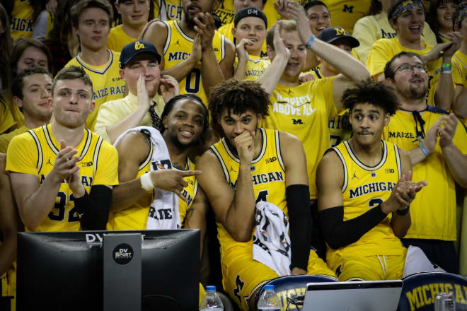The team mugs with the Maize Rage postgame.