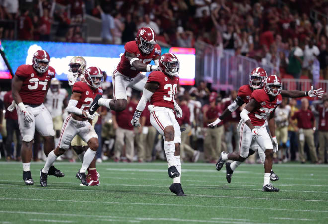 Alabama Crimson Tide linebacker Mack Wilson (30) celebrates his interception with defensive back Ronnie Harrison (15) in the 4th quarter against the Florida State Seminoles at Mercedes-Benz Stadium. Photo   USA Today