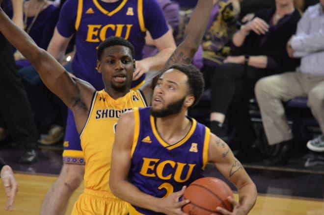 ECU's K.J. Davis drives on Wichita State's Jamarius Burton in Wednesday night's Pirate loss in Minges Coliseum.
