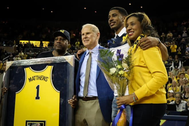 Charles Matthews and family with Beilein.