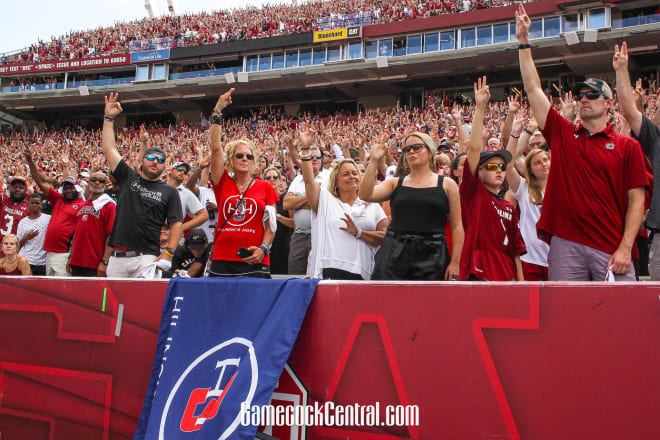 South Carolina fans hold up three fingers for mental health awareness.