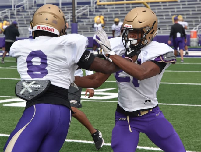 James Madison safety Adam Smith (right) works against spur Wayne Davis during a drill at Dukes practice last week in Harrisonburg.