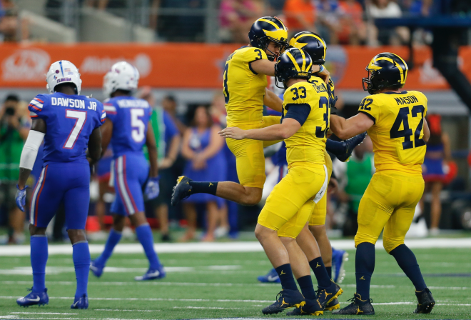 MI football's Jim Harbaugh won't reveal starting quarterback