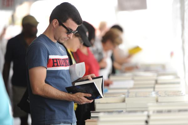 Man browses book at the Texas Book Festival