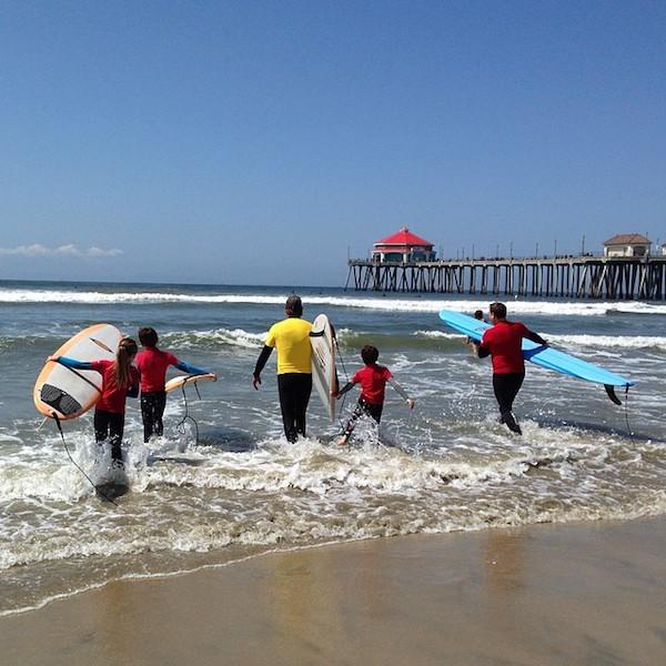 Shelby's kids took a surf lesson with local HB Surf School