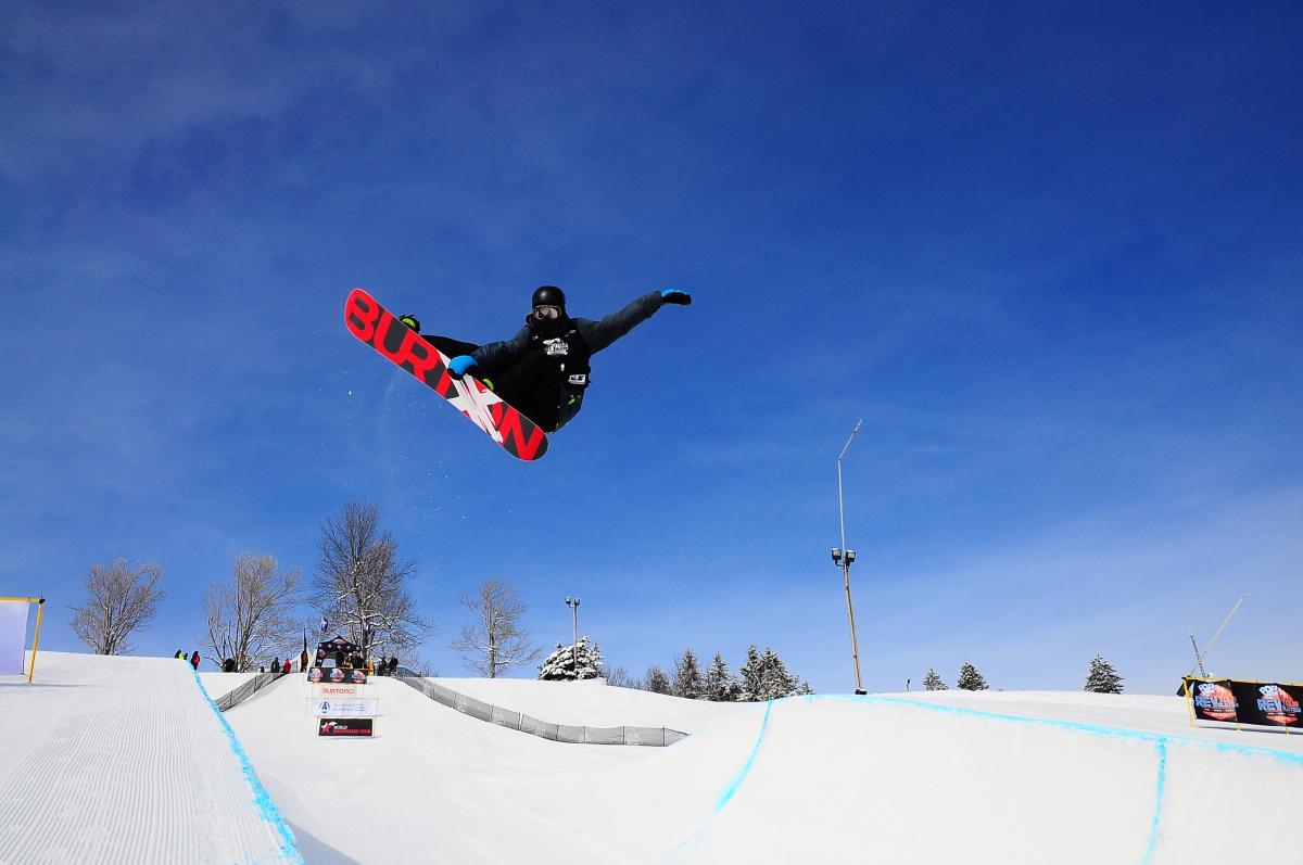 Snowboarding stunts at Seven Springs Mountain Resort Half Pipe in Laurel Highlands, PA