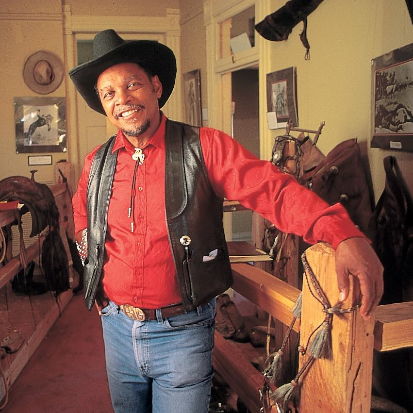 A local cowboy poses inside the Black American West Museum.
