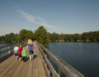 family walking on bridge