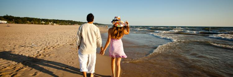 Beach couple walking