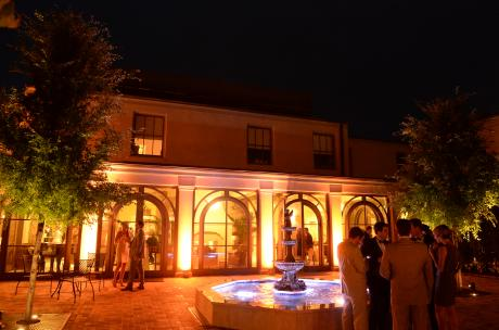 People mingling in the courtyard at the Southern Hotel at night