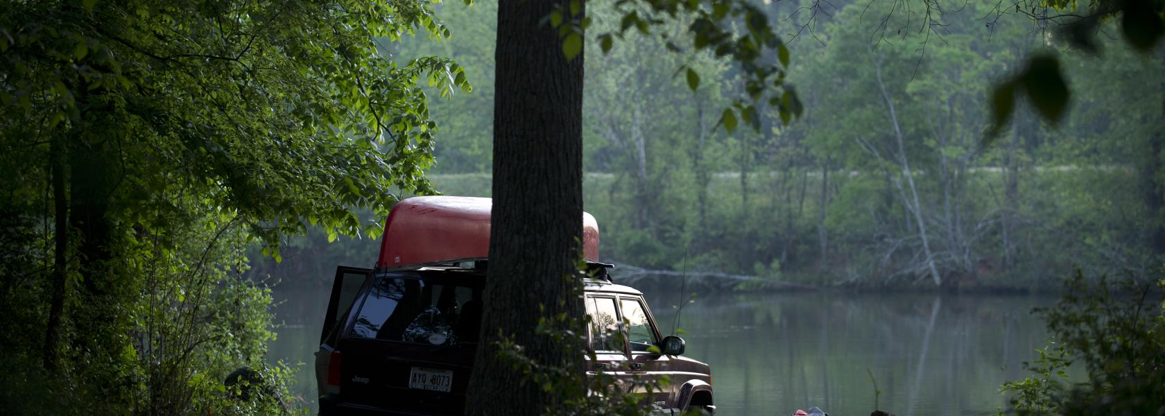 canoe and truck at river bank