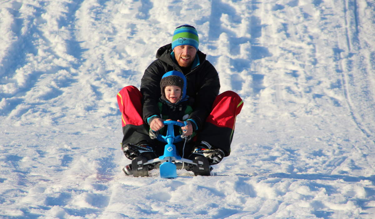 Father and son sledging at Sandrip in Kristiansand