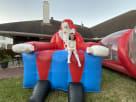 inflatable santa party rentals