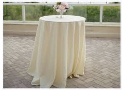 Round cocktail table with Ivory tablecloth