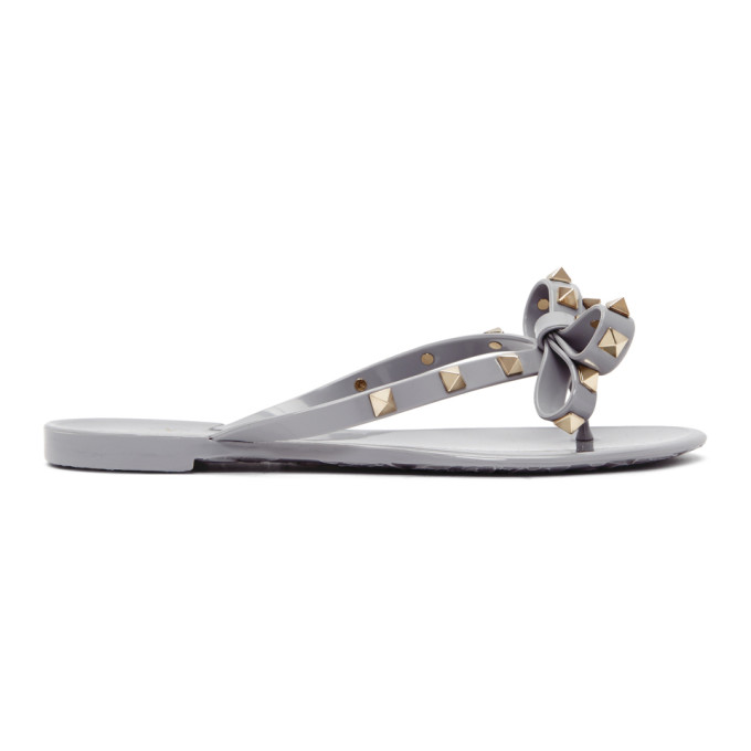 b3db2204d grey-valentino-garavani-rockstud-jelly-bow-sandals by valentino
