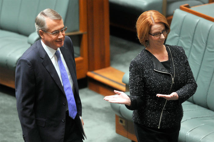 Then Prime Minister Julia Gillard gestures to Treasurer Wayne Swan as they arrive at Parliament House in May, 2015. Picture: Alan Porritt/AAP