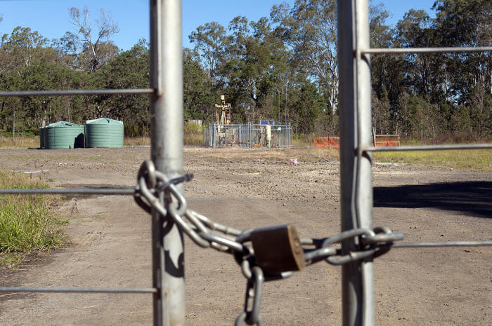 A coal seam gas well behind a locked gate near Casino, Northern NSW. Photo by Jeremy Buckingham via Flickr.