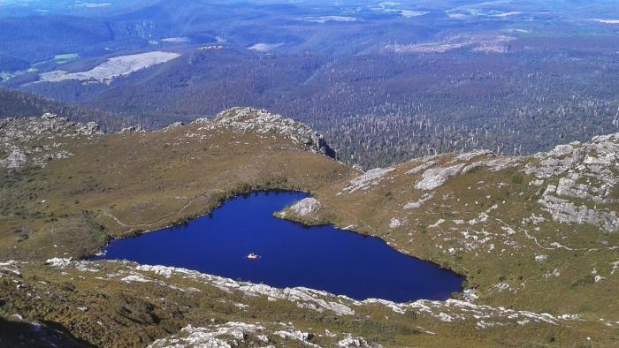 """Our deep lake coring platform on Paddy's Lake in northwest Tasmania. This site required helicopter support to access. Here we are investigating whether there are any linkages between terrestrial vegetation change and aquatic ecosystem dynamics."" – Dr Fletcher. Picture: William Rapuc"