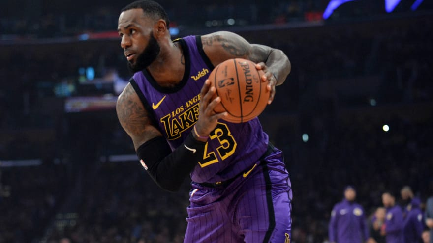 970c3204a7ee Watch  LeBron James  14-year-old son Bronny dunks at Staples Center ...