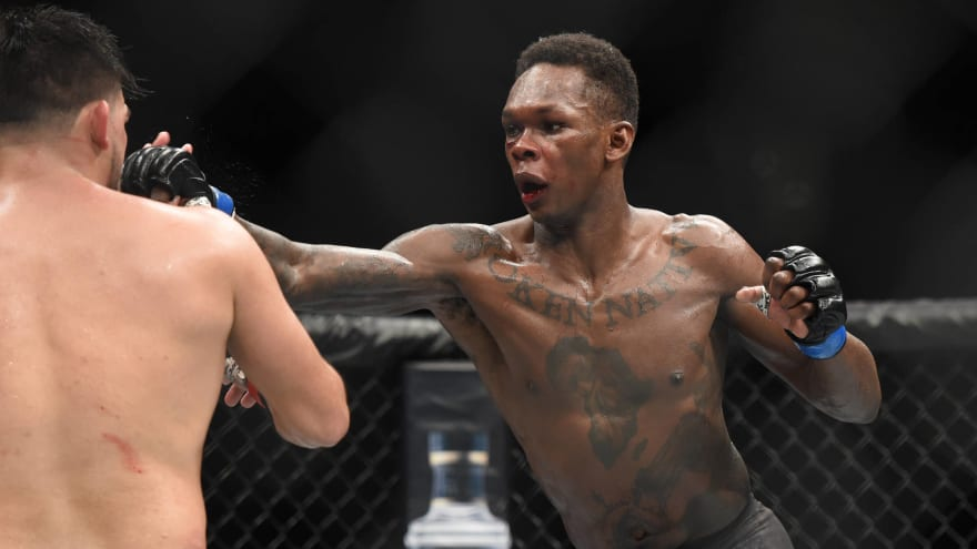 Israel Adesanya has great walk out, then wins with 2nd-round TKO